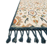 cream bohemian style rug with blue outline and multi-colored detail