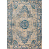 distressed cream area rug with blue traditional detail