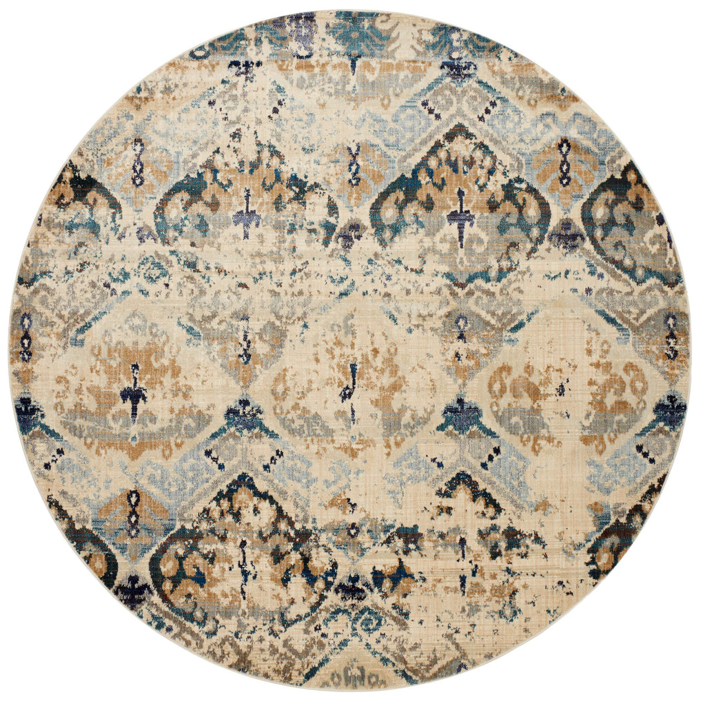 distressed cream circle rug with dark grey, blue, and beige detail