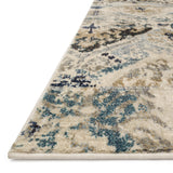distressed cream rug with dark grey, blue, and beige detail