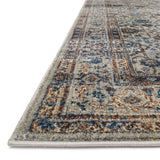 distressed dark slate area rug with blue and grey floral detail