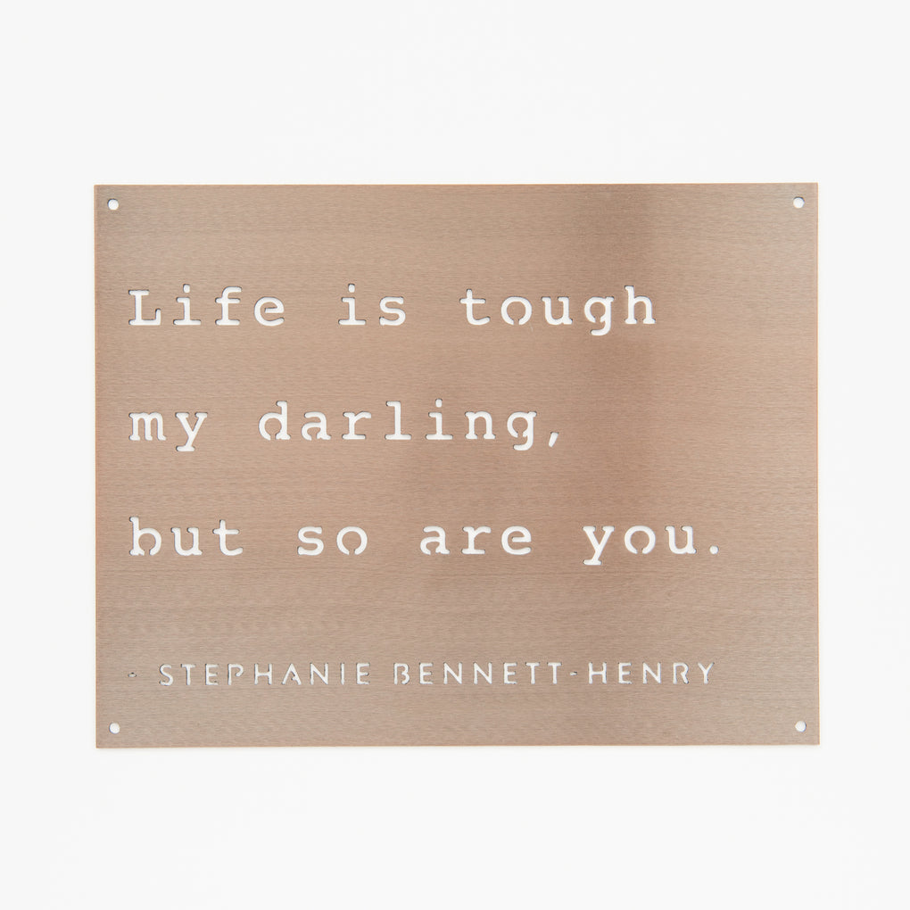 copper powder-coated metal sign with quote reading life is tough my darling but so are you