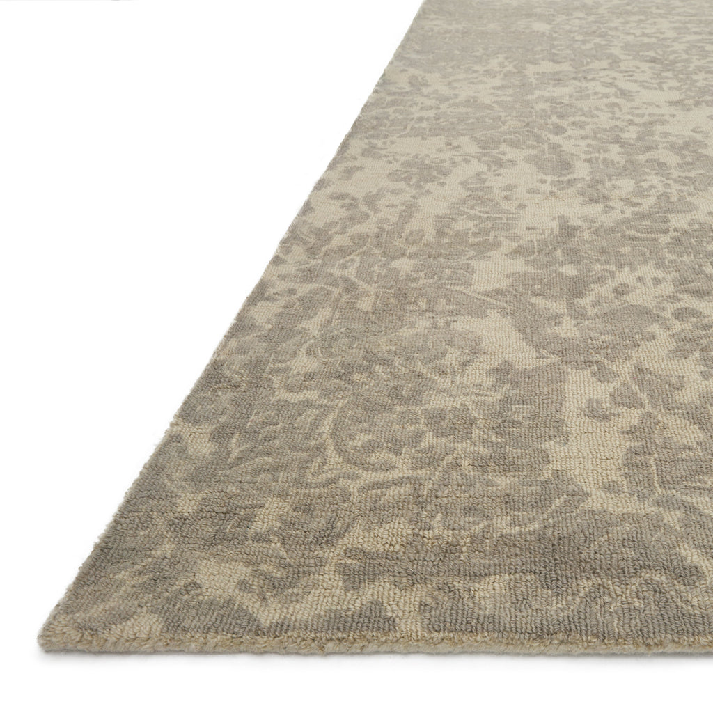 tan distressed rug with ivory undertones