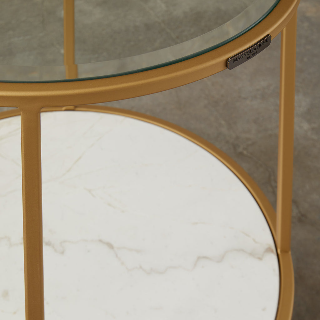 gold finished metal circle side table with glass top and marble shelf
