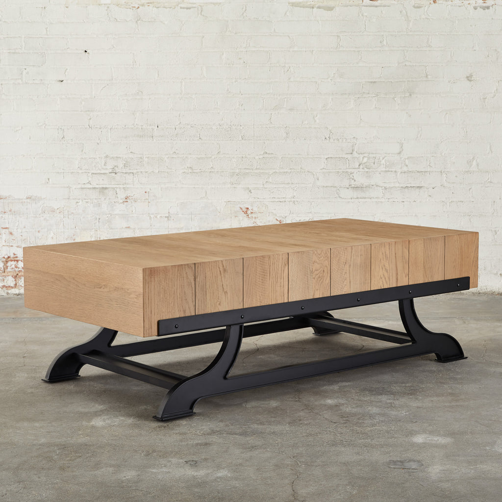 industrial coffee table with wheat color wood top and black metal base