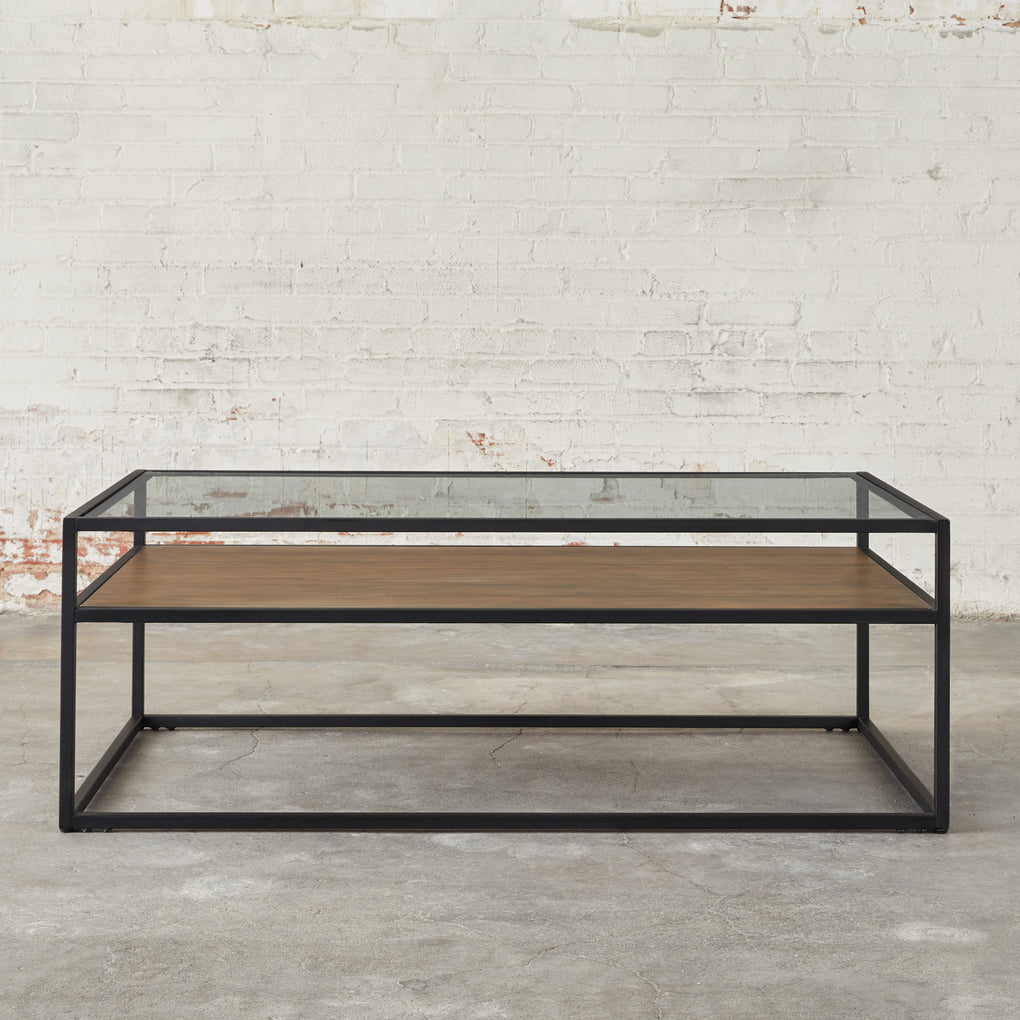 black metal framed coffee table with glass top and wooden shelf
