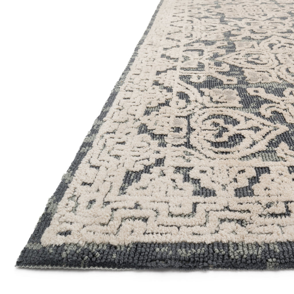 dark grey and beige area rug with floral patterns