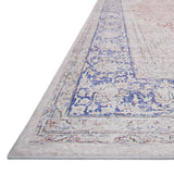 light blue distressed traditional rug with floral patterns and light orange detail