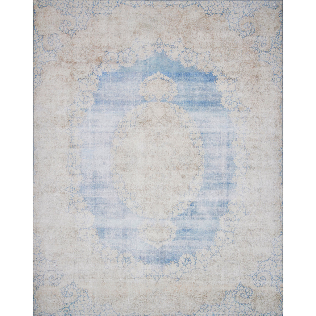 distressed light blue and cream rug with ornate pattern