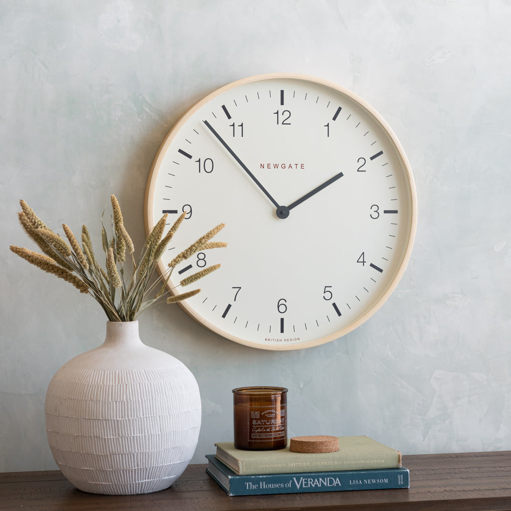 large white-faced clock with natural colored plywood frame