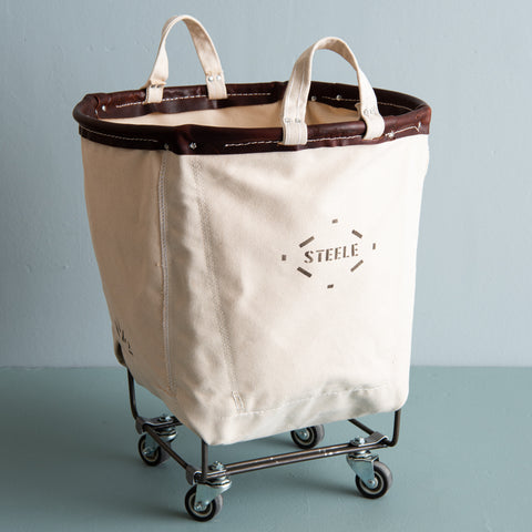 round canvas hamper with rolling steel frame and carry handles