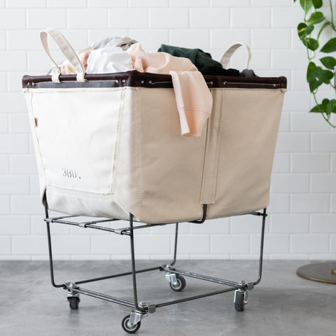large elevated canvas hamper with rolling steel frame