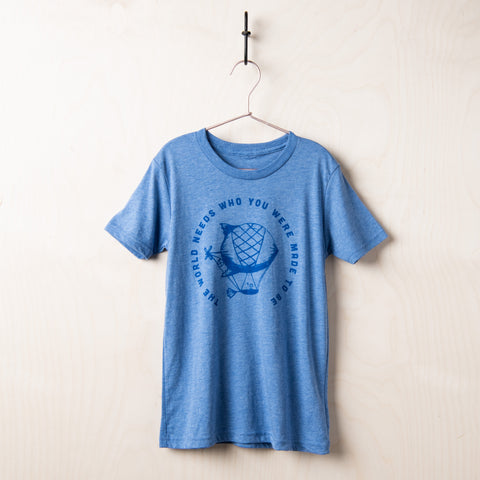 "blue kids t-shirt with a hot-air balloon graphic and the title of Joanna Gaines' kids book ""the world needs who you were made to be"""