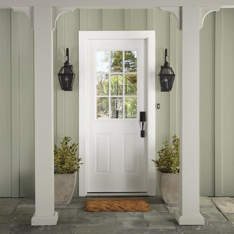 Muted apple green with gray accents exterior paint