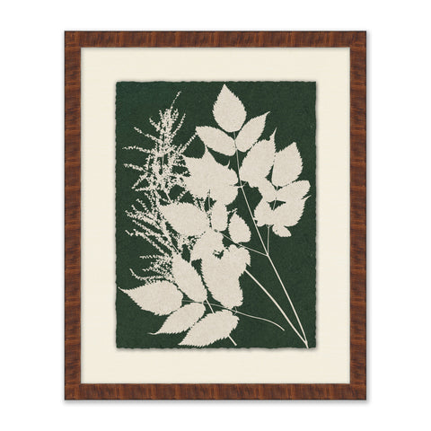 white silhouette of leaves on green background painting in wooden frame with cream mat