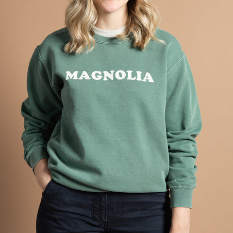 "soft green sweatshirt with ""magnolia"" in cooper font across chest"