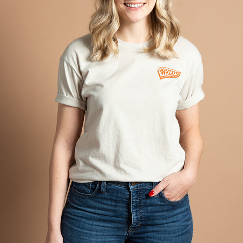 tan t-shirt with waco pennant flag logo in orange
