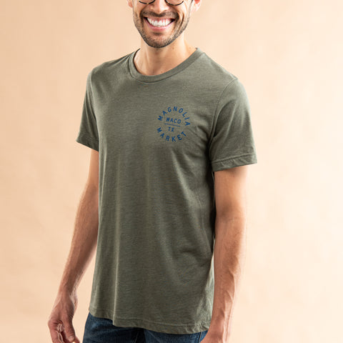 heathered olive green t-shirt with circle crest magnolia logo in blue on left chest