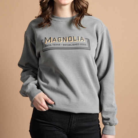 "grey sweatshirt with retro graphic reading ""Magnolia 