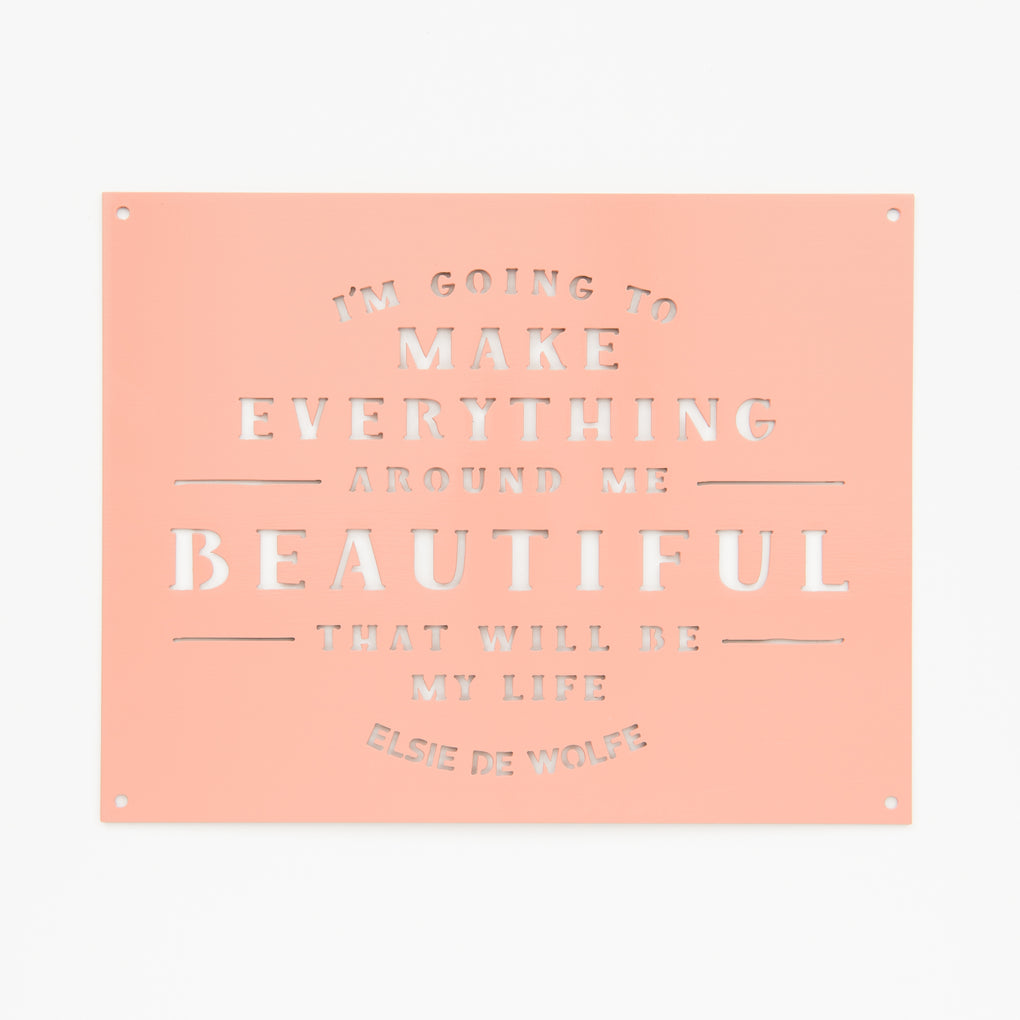blush color powder coated metal sign with quote from Elsie De Wolfe reading I'm going to make everything around me beautiful that will be my life