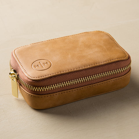 light brown leather zip-up portable jewelry case