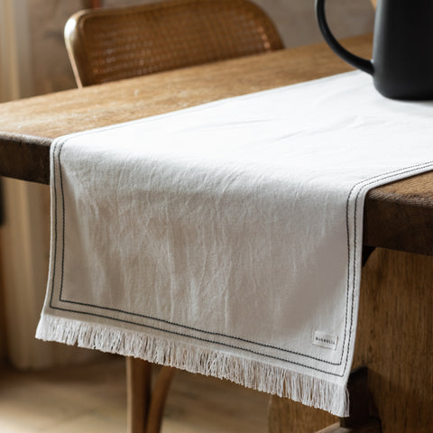 white table runner with grey stitching