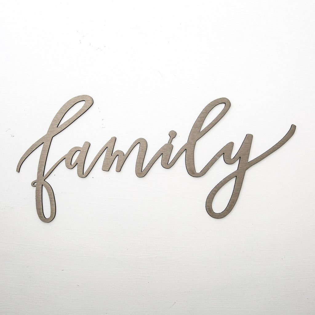 "metal script wall expression that says ""family"""