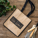 natural colored tote with black Magnolia seed and supply logo