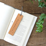 wooden bookmark with magnolia logo