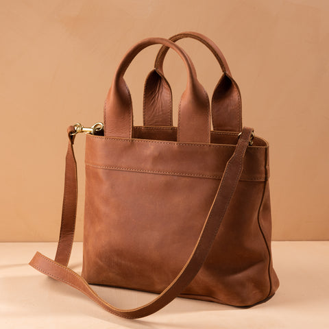 brown leather convertible handbag and crossbody purse