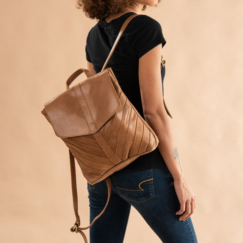 brown leather backpack with herringbone pattern stitching