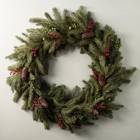 faux fir wreath with pinecones and red berries