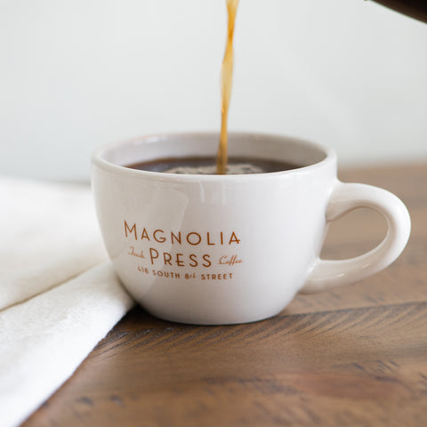 white ceramic latte mug with Magnolia Press Coffee Co logo in gold