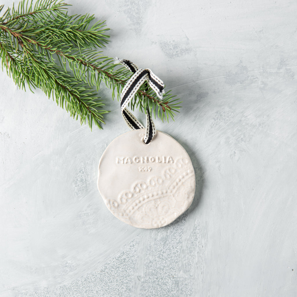 white ceramic magnolia christmas ornament