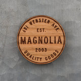 laser engraved wooden magnet with Magnolia circle crest logo