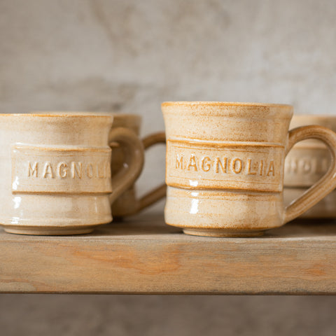 hand thrown ceramic tan mug with darker tan speckling
