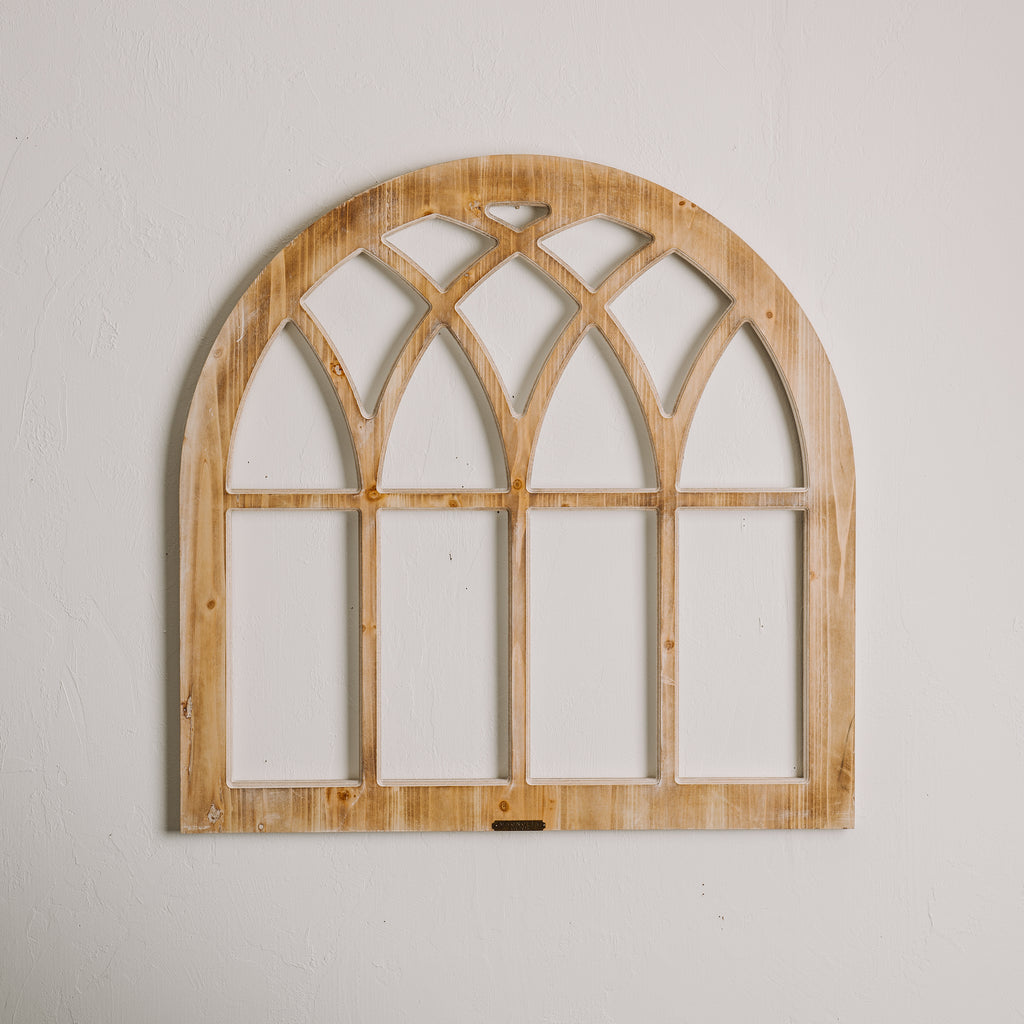 Arched wooden window frame magnolia chip joanna gaines for Window frame designs house design