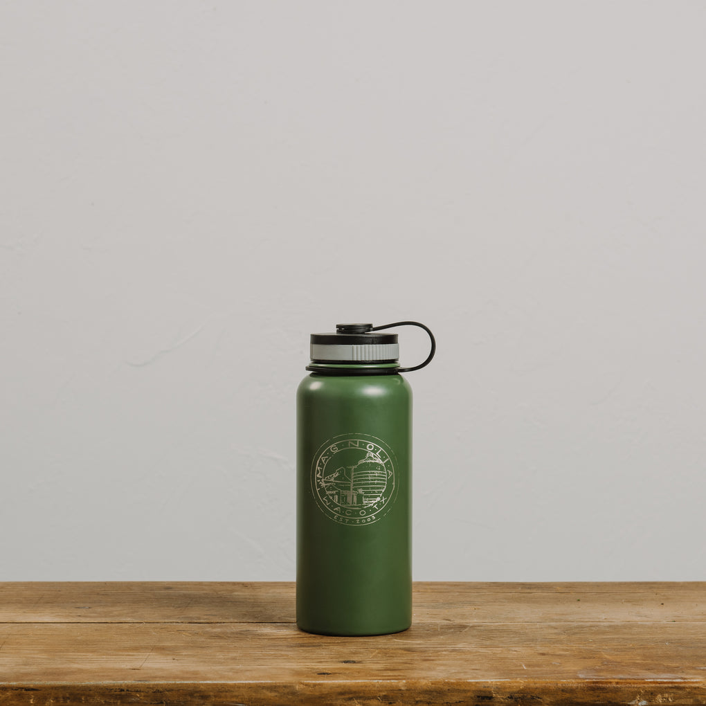 green insulated metal water bottle with magnolia silos seal logo