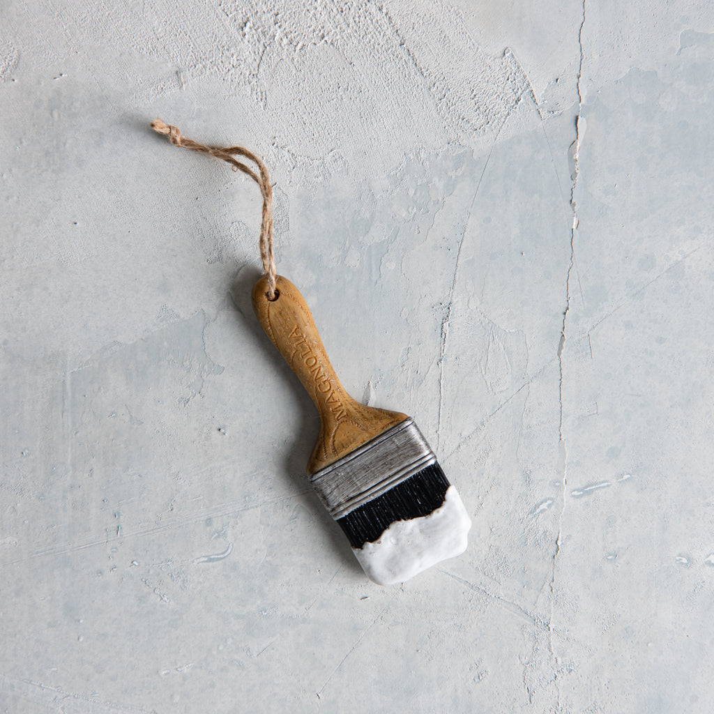 magnolia paint brush dipped in white paint christmas ornament