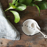 white stoneware distressed spoon rest with black rim