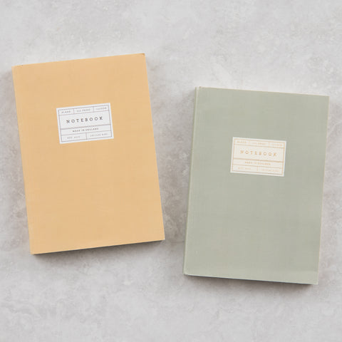 mustard yellow notebook that lays flat