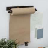 hanging black metal bracket and paper scroll