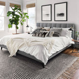 modern charcoal and ivory rug with geometric pattern and tassel fringe