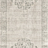 distressed taupe runner rug with ornate pattern
