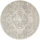 distressed taupe round rug with ornate pattern