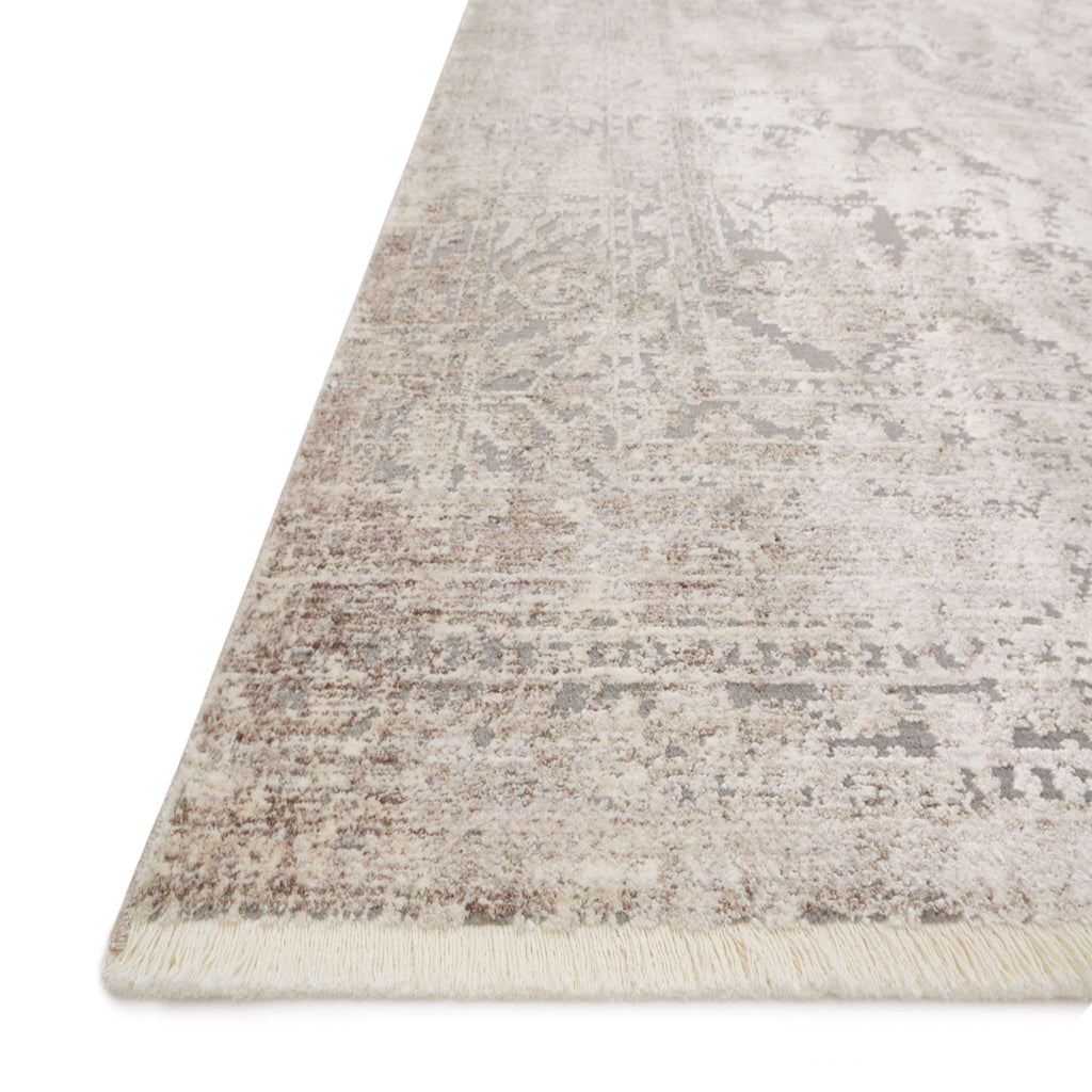 distressed taupe rug with ornate pattern