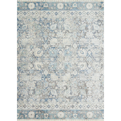 distressed light blue and grey rug with floral pattern