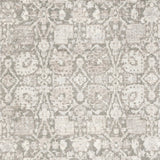 distressed taupe and grey runner rug with floral pattern