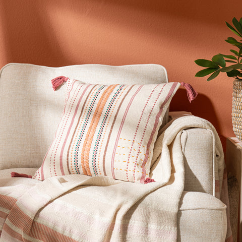 modern multi-colored striped pillow with pink tassels