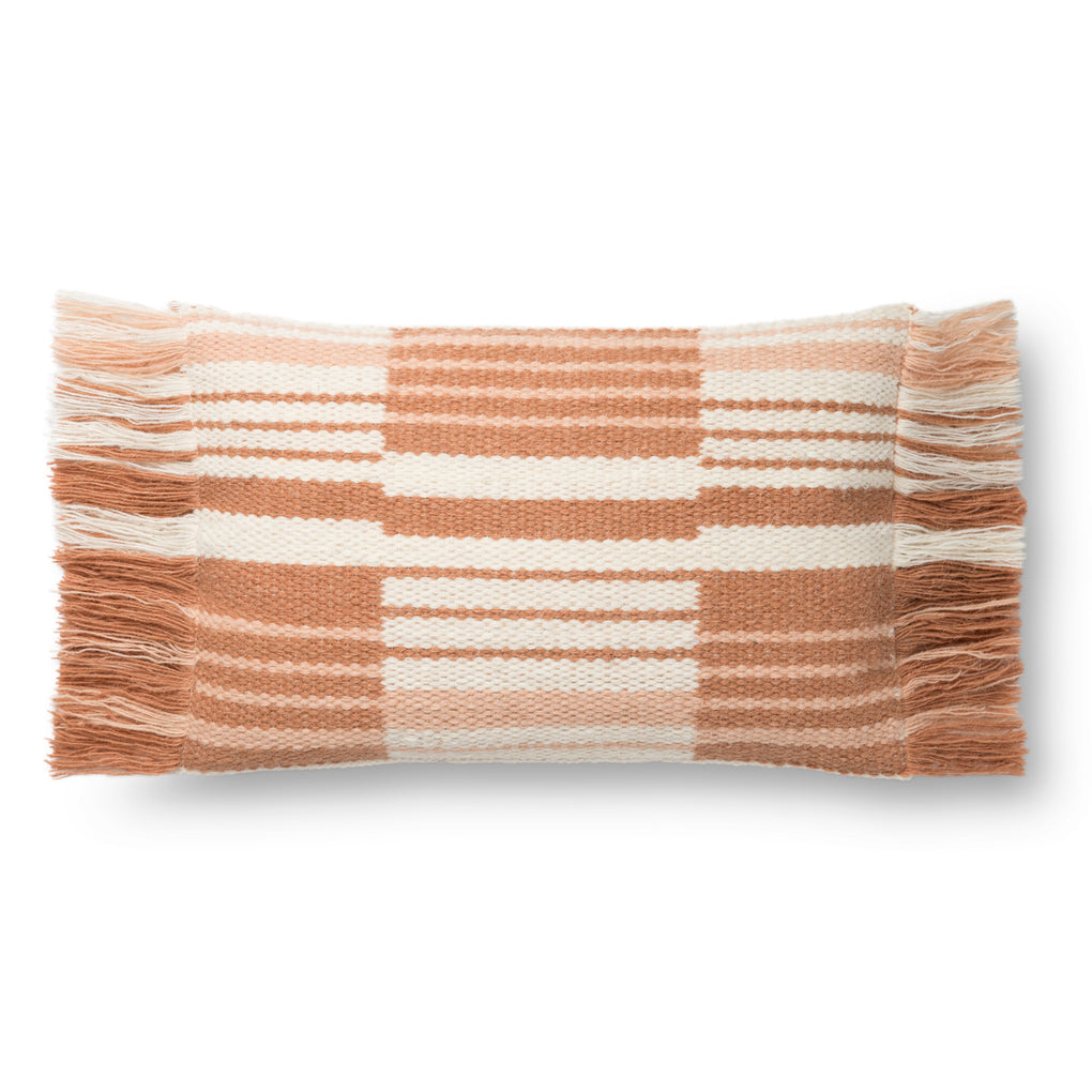terracotta and white rectangular pillow with tassel fringe